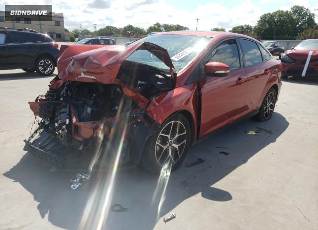 Lot #1776619710 2018 FORD FOCUS SEL salvage car